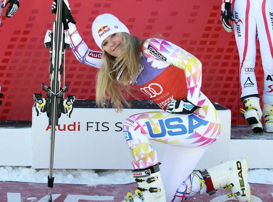 FILE - In this Dec. 7, 2011 file photo, Lindsey Vonn kneels down in front of the podium after winning the women's World Cup Super G ski competition in Beaver Creek, Colo. Vonn was supposed to make her World Cup return this week on a course almost custom-made for her. But after re-injuring her knee last week, the four-time World Cup champ is sitting this one out. (AP Photo/Alessandro Trovati, File) / AP