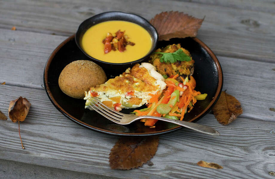 AP Photo / Matthew MeadThis Oct. 15, 2012 file photo shows a vegetarian Thanksgiving dinner, in Concord, N.H. In homes across the country on Thanksgiving Day, tables will be set to accommodate everyone from vegans and vegetarians to those trying to eat like a caveman. / FR170582