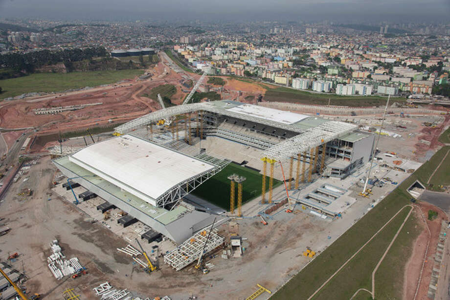 This Oct. 22, 2013 photo released by Portal da Copa 2014, shows an aerial view of the Itaquerao stadium, in Sao Paulo, Brazil. Part of the stadium that will host the World Cup opener in Brazil next year, collapsed Wednesday, Nov. 27, 2013, causing significant damage and killing three people, authorities said. (AP Photo/Delfim Martins-Portal da Copa 2014) / Portal da Copa 2014