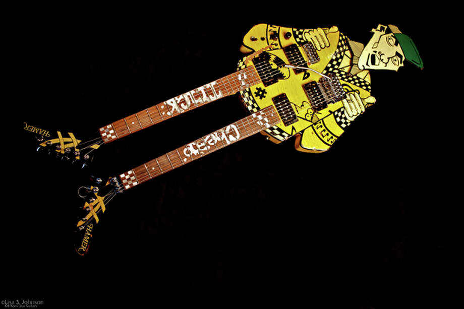 "This May 5, 2011 photo provided by Lisa S. Johnson shows a double-neck guitar named ""Uncle Dick,"" owned by Rick Nielsen of the group Cheap Trick. It appears in Johnson's new book, ""108 Rock Star Guitars,"" which celebrates instruments owned by celebrities and virtuoso sidemen as a form of visual art. (AP Photo/Lisa S. Johnson) / Lisa S. Johnson"