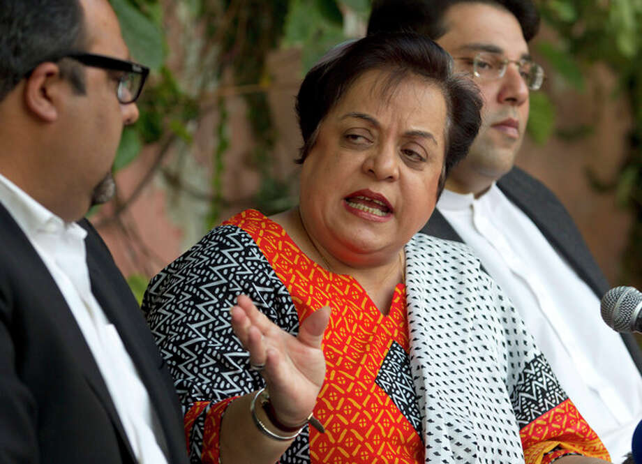 Shireen Mazari, center, information secretary of the Pakistan Tehreek-e-Insaf party, addresses a news conference with party officials in Islamabad, Pakistan, Wednesday, Nov. 27, 2013. A political party opposed to U.S. drone attacks in Pakistan revealed what it said was the name of the top CIA spy in the country on Wednesday and called for him and the head of the agency to be tried for a recent missile strike. Pakistani police and intelligence officials have said the attack on an Islamic seminary in Khyber Pakhtunkhwa's Hangu district on Nov. 21 killed five people. (AP Photo/B.K. Bangash) / AP