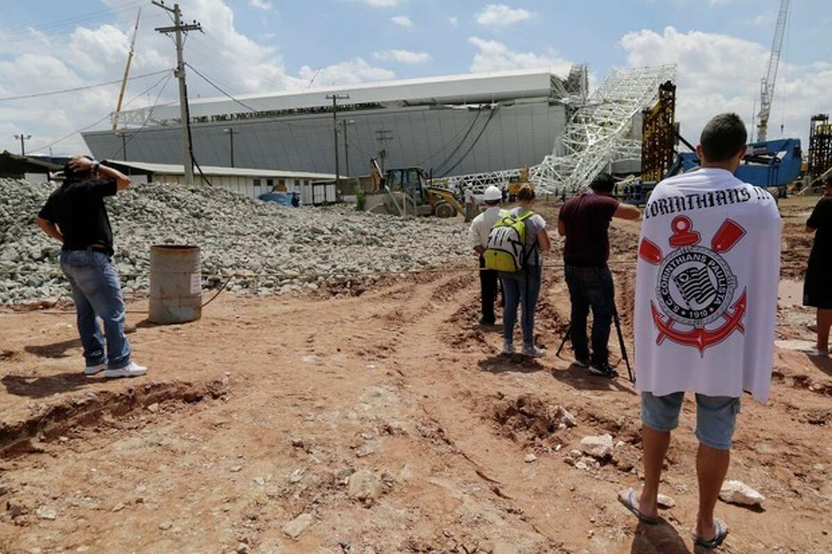 AP Photo/Nelson Antoine A metal structure that buckled is seen atop a part of the Itaquerao Stadium in Sao Paulo, Brazil, Wednesday, Nov. 27. Part of the Itaquerao stadium that will host the 2014 World Cup opener in Brazil collapsed on Wednesday, causing significant damage and killing three people, authorities said.