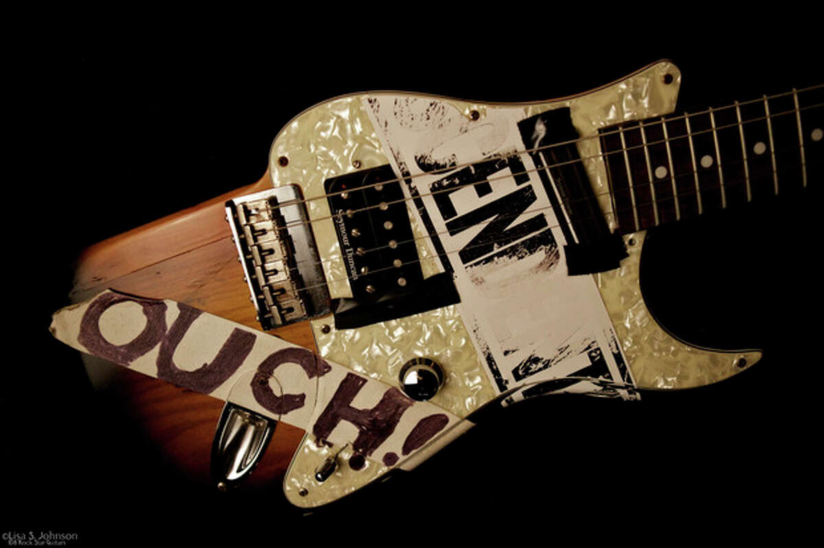 This Dec. 15, 2011 photo provided by Lisa S. Johnson shows a guitar owned by John Rzeznik of the Goo Goo Dolls. Rzeznik resurrected a broken Stratocaster into a 4-string, named Halfcaster, and used it on a song called ?