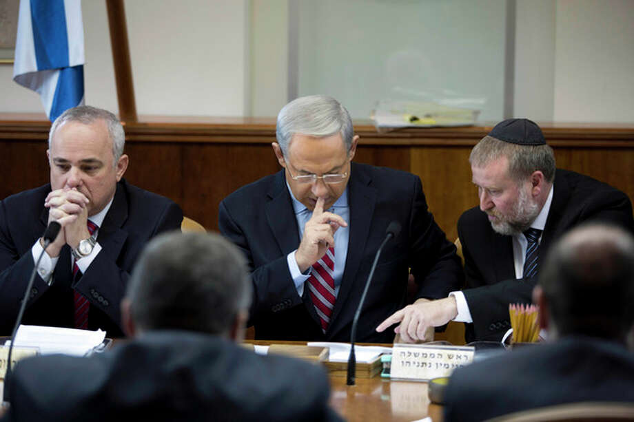 Israeli Prime Minister Benjamin Netanyahu chairs the weekly cabinet meeting at his office in Jerusalem, Israel, Sunday, Nov. 24, 2013. After feverishly trying to derail the international community's nuclear deal with Iran in recent weeks, Israeli Prime Minister Benjamin Netanyahu now has little choice but to accept an agreement that he has derided as deeply flawed. (AP Photo/Abir Sultan, Pool) / EPA POOL