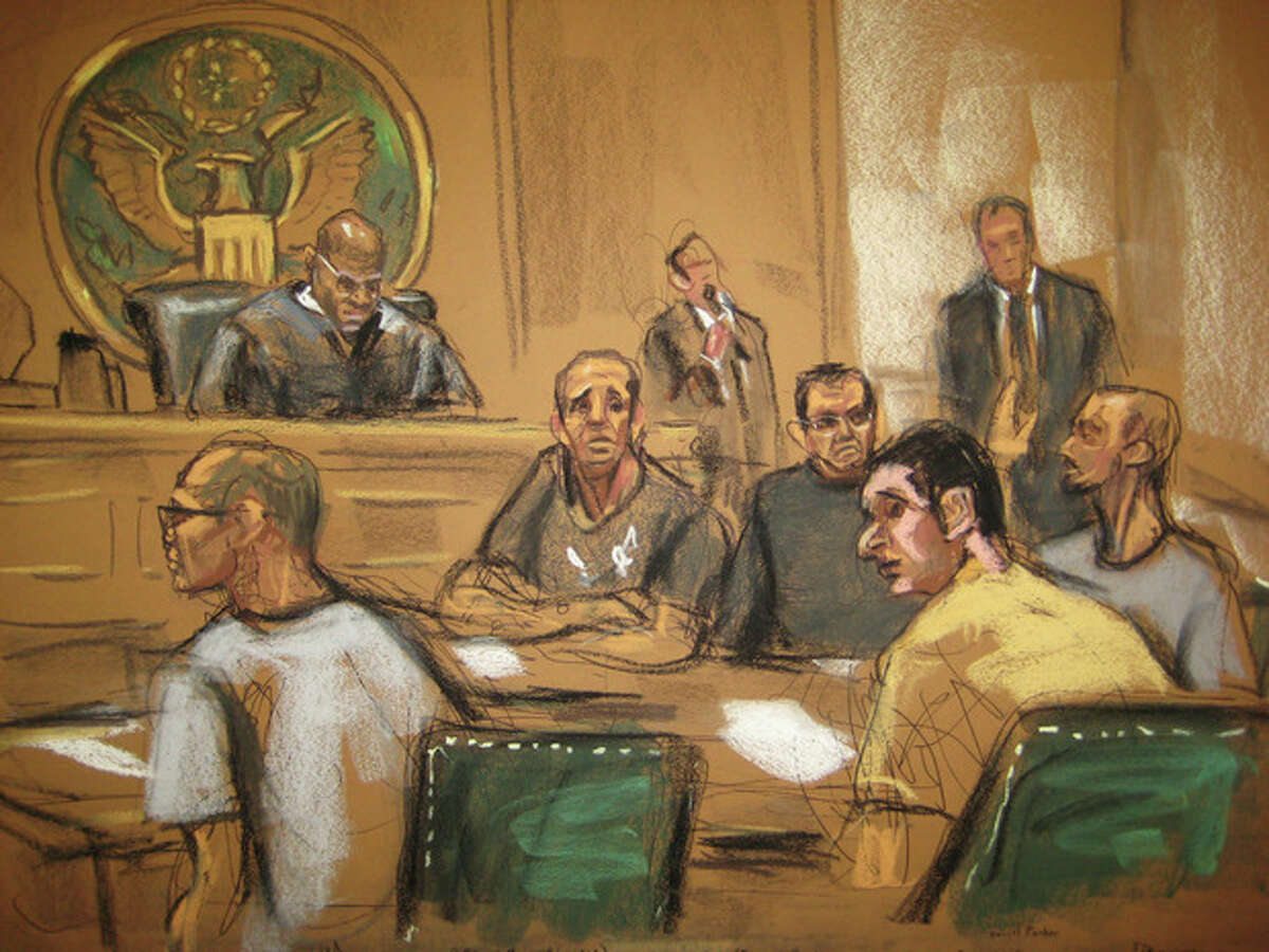 In this Nov. 21, 2013 courtroom art, five men appear in a New York City courtroom accused of plotting to smuggle 100 kilograms of highly potent methamphetamine produced in North Korea into the United States. Magistrate judge Nathaniel Fox is on the bench in the upper left. At left foreground is Ye Tiong Tan Lim. Seated in the rear from left are a man who called himself Lnu, who is also known as Adrian Valkovec; Allan Kelly Reyes Peralta; and Philip Shackles. Scott Stammers is seated in the right foreground. Standing at rear is an unidentified interpreter and attorney Daniel Parker. (AP Photo/Jane Rosenberg)