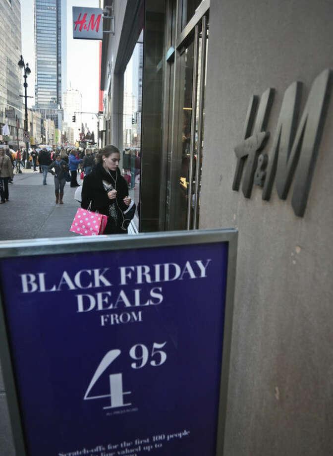 "An H&M store advertises ""Black Friday Deals"" on Saturday, Nov. 23, 2013, in New York. (AP Photo/Bebeto Matthews)"