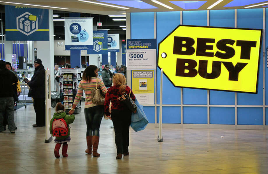 Shoppers enter a Best Buy on Saturday, Nov. 23, 2013, in New York. Despite signs that the economy is improving, big store chains like Wal-Mart and Kohl's don't expect Americans to have much holiday shopping cheer unless they see bold, red signs that offer huge discounts. (AP Photo/Bebeto Matthews) / AP