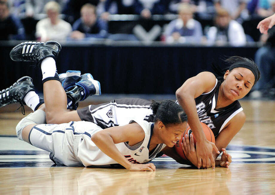 AP photoConnecticut's Moriah Jefferson, front, and St. Bonaventure's Gabby Richmond fight for a loose ball during the first half of Sunday's game in Hartford. The Huskies won 88-39. / FR153656 AP