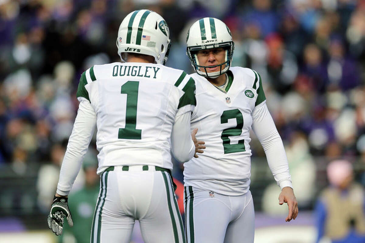New York Jets kicker Nick Folk (20 is congratulated by punter Ryan Quigley after his field goal during the first half of an NFL football game against the Baltimore Ravens in Baltimore, Md., Sunday, Nov. 24, 2013. (AP Photo/Patrick Semansky)
