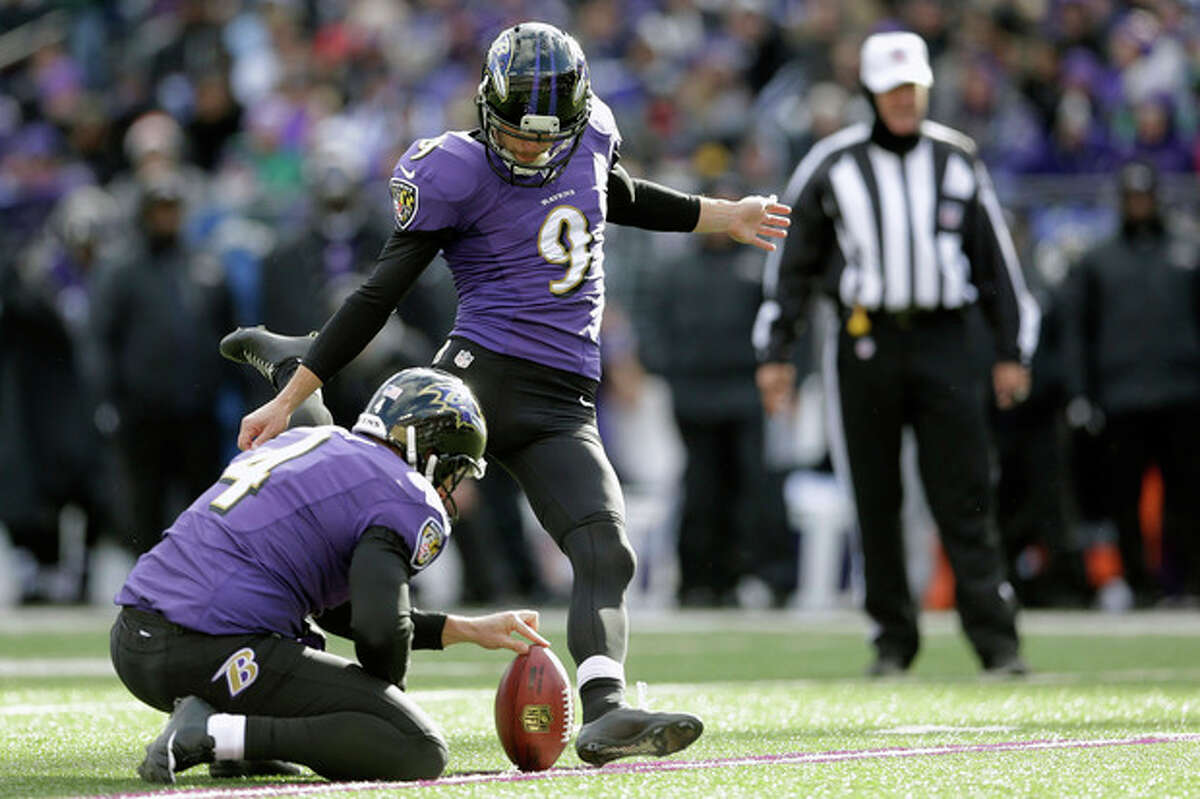 Baltimore Ravens' Justin Tucker (9) kicks a field goal during the first half of an NFL football game against the New York Jets in Baltimore, Md., Sunday, Nov. 24, 2013. (AP Photo/Patrick Semansky)