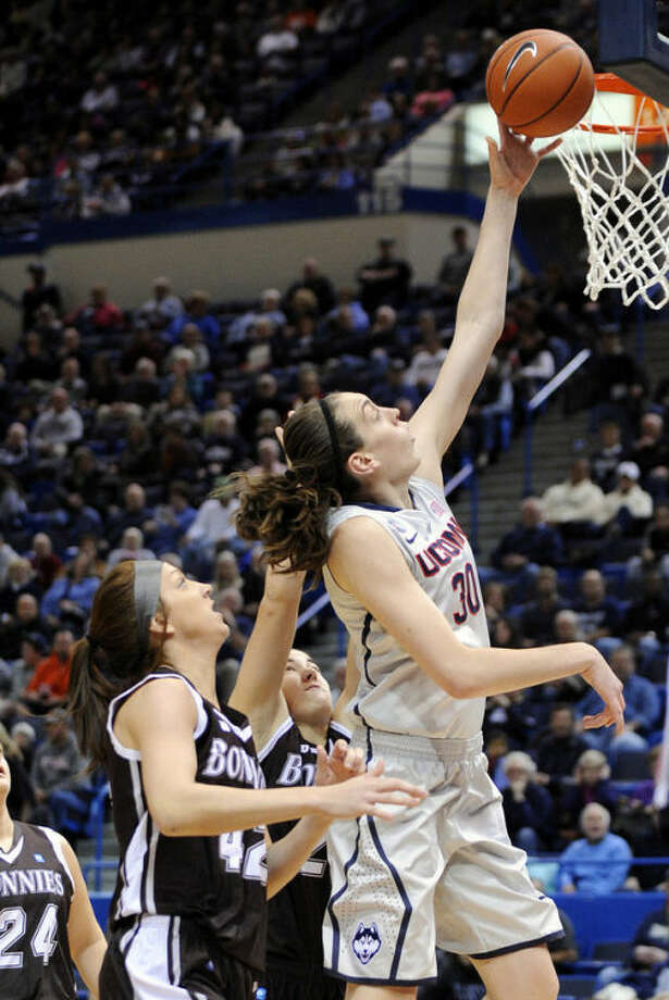 Connecticut's Breanna Stewart (30) drives past St. Bonaventure's Katie Healy (42) during the first half of an NCAA college basketball game in Hartford, Conn., on Sunday, Nov. 24, 2013. (AP Photo/Fred Beckham)