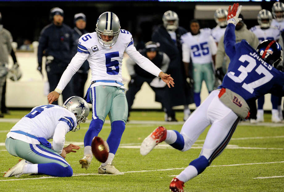 Dallas Cowboys kicker Dan Bailey (5), with Chris Jones holding, kicks a game-winning field goal against the New York Giants during the second half of an NFL football game, Sunday, Nov. 24, 2013, in East Rutherford, N.J. The Cowboys won 24-21. (AP Photo/Bill Kostroun) / FR51951 AP