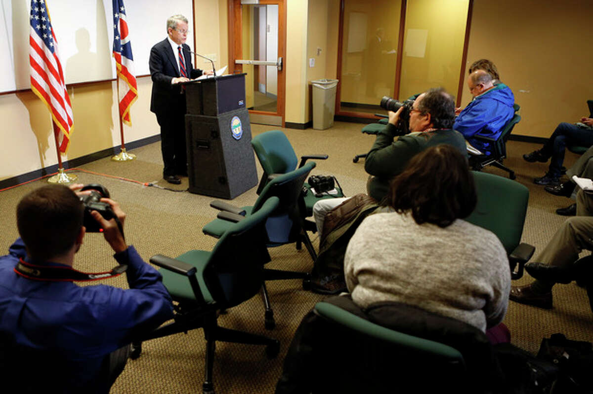Ohio Attorney General Mike DeWine answers questions at a news conference where he announced indictments against four additional people in relation to the 2012 rape of a high school student on Monday, Nov. 25, 2013 in Steubenville, Ohio. The charges against Superintendent Mike McVey include felony counts of obstructing justice, DeWine said. An elementary school principal, Lynnett Gorman, 40, and a strength coach, Seth Fluharty, 26, are charged with failing to report possible child abuse. A former volunteer coach, Matthew Bellardine, 26, faces several misdemeanor charges, including making false statements and contributing to underage alcohol consumption. (AP Photo/Keith Srakocic)