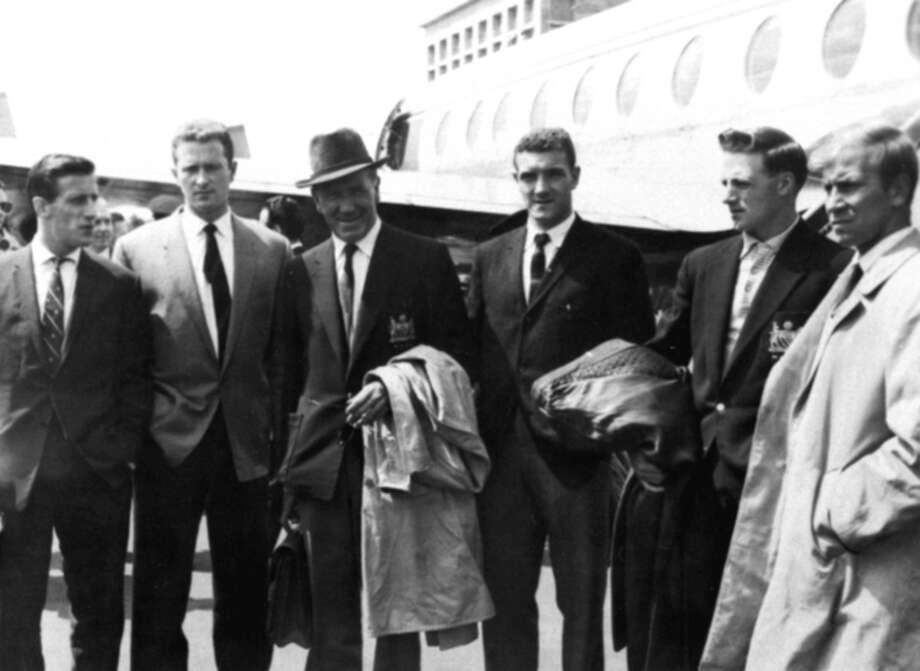 FILE - This is a Aug. 7, 1959 file photo of Manchester United players and manager as they visit Munich Airport, where an air disaster claimed the lives of 8 of their team in February 1958. From left to right they are Denis Violet, Bill Foulkes, Matt Busby, manager, Harry Gregg, Albert Scanlon, and Bobby Charlton. Bill Foulkes, who survived the 1958 Munich air disaster, died Monday, Nov. 25,. 2013 the club said. He was 81. Foulkes, who left a mining job to join United in 1950, went on to play 688 times after making his debut in 1952. Only Ryan Giggs, Bobby Charlton and Paul Scholes have played more times for the club. (AP Photo, File) / AP