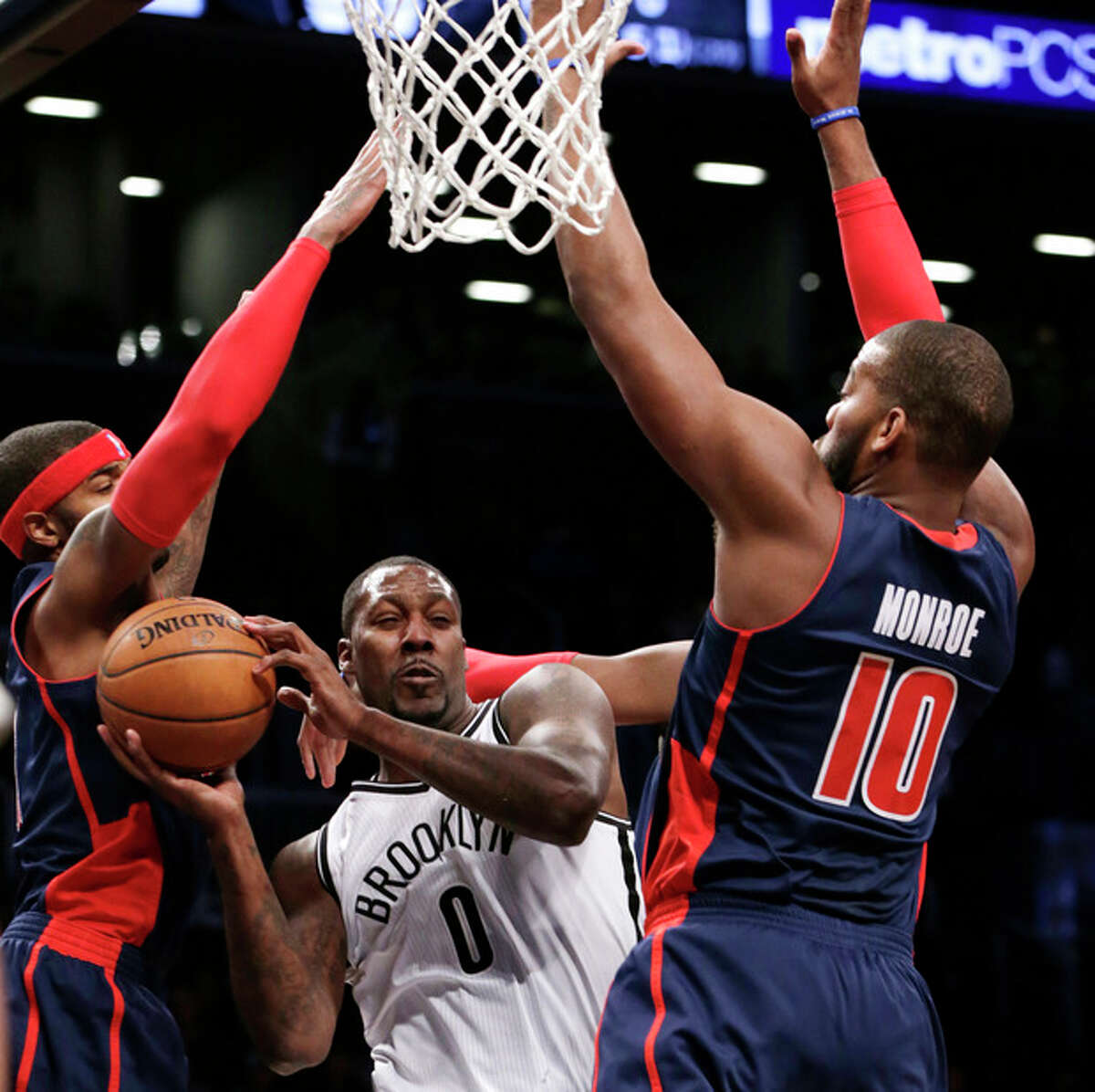 Brooklyn Nets center Andray Blatche (0) looks to pass as Detroit Pistons forward Greg Monroe (10) tries to block him in the first half of an NBA basketball game, Sunday, Nov. 24, 2013, in New York. (AP Photo/Kathy Willens)