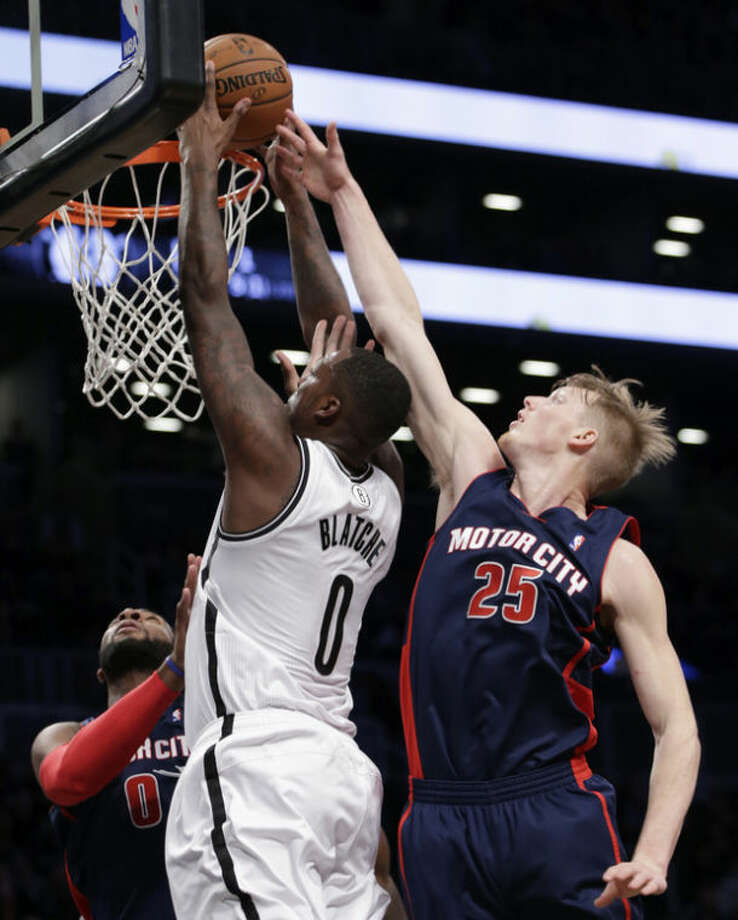 Detroit Pistons forward Kyle Singler (25) tries to block a shot by Brooklyn Nets center Andray Blatche (0) in the first half of an NBA basketball game, Sunday, Nov. 24, 2013, in New York. (AP Photo/Kathy Willens)