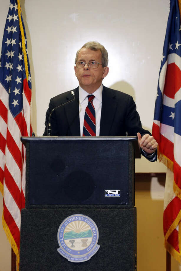 Ohio Attorney General Mike DeWine announces indictments against four additional people in relation to the 2012 rape of a high school student, on Monday, Nov. 25, 2013 in Steubenville, Pa. The charges against Superintendent Mike McVey include felony counts of obstructing justice, DeWine said. An elementary school principal, Lynnett Gorman, 40, and a strength coach, Seth Fluharty, 26, are charged with failing to report possible child abuse. A former volunteer coach, Matthew Bellardine, 26, faces several misdemeanor charges, including making false statements and contributing to underage alcohol consumption. (AP Photo/Keith Srakocic)