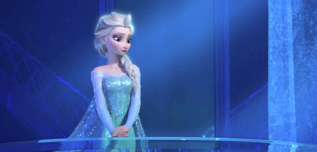 This image released by Disney shows a teenage Elsa the Snow Queen, voiced by Maia Mitchell, in a scene from the animated feature