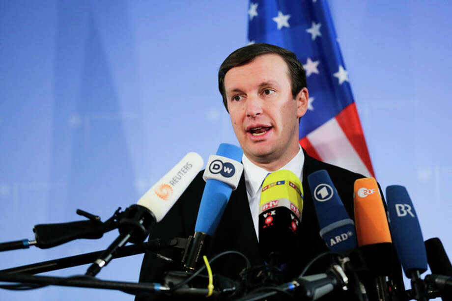 Sen. Christopher Murphy a Connecticut Democrat who serves on the Senate Foreign Relations Committee, briefs the media prior to a meeting with Congressman Gregory Meeks and German Foreign Minister Guido Westerwelle at the foreign ministry in Berlin, Monday, Nov. 26, 2013. Following allegations of massive National Security Agency surveillance the politicians will discuss the relationship between the countries and how to restore trust to trans-Atlantic ties. (AP Photo/Markus Schreiber) / AP
