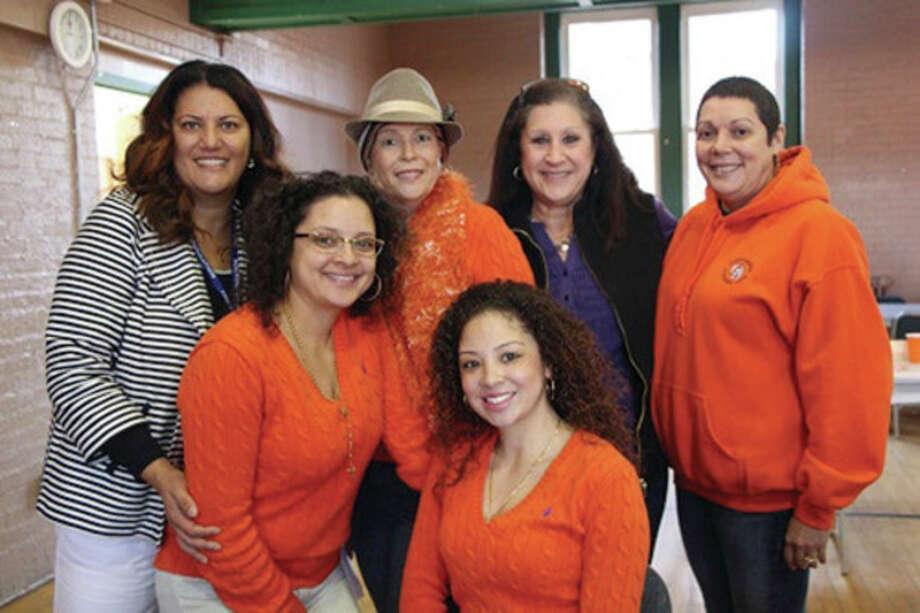 At a bone marrow donor drive in honor of Joan Luna Zayas, of Meriden, in rear, are Patricia Fernandes of the ICLA da Silva Foundation, Joan Luna Zayas, organizer Karen Pomarico, Zayas' sister Judy Luna, and in front, her daughters Natasha and Vanessa Ramirez. / JESSENIA NARVAEZ