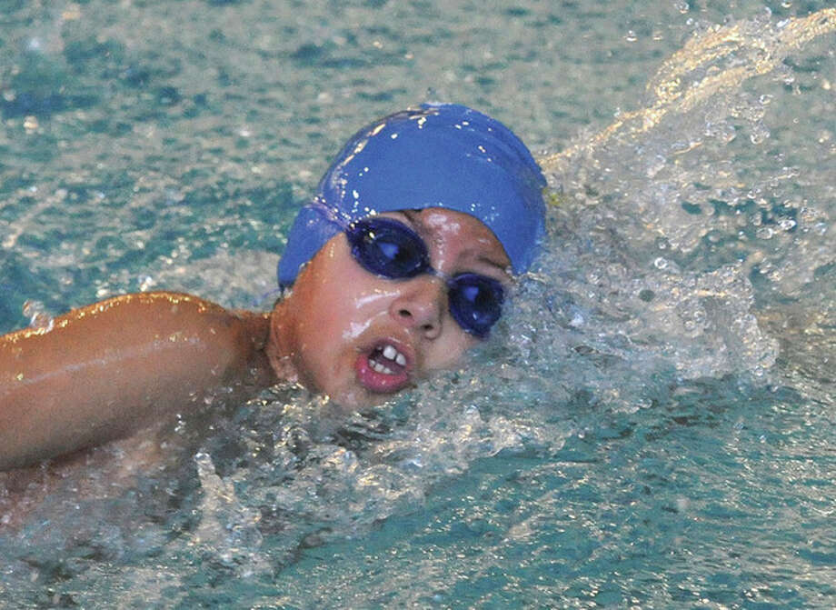 Hour photo/Matthew VinciMarcelo Leite competes in the boys 200 freestyle event Sunday at the Betty Philcox Invitational in Norwalk.