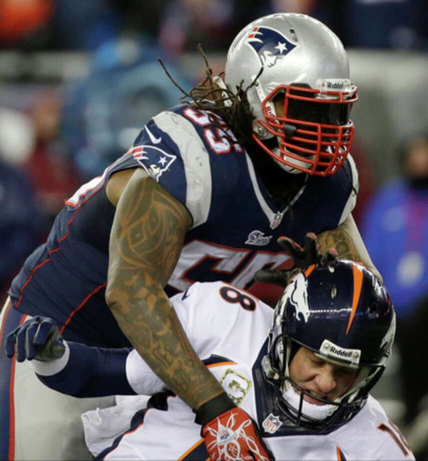 New England Patriots middle linebacker Brandon Spikes (55) knocks down Denver Broncos quarterback Peyton Manning (18) in the fourth quarter of an NFL football game Sunday, Nov. 24, 2013, in Foxborough, Mass. (AP Photo/Stephan Savoia) / AP