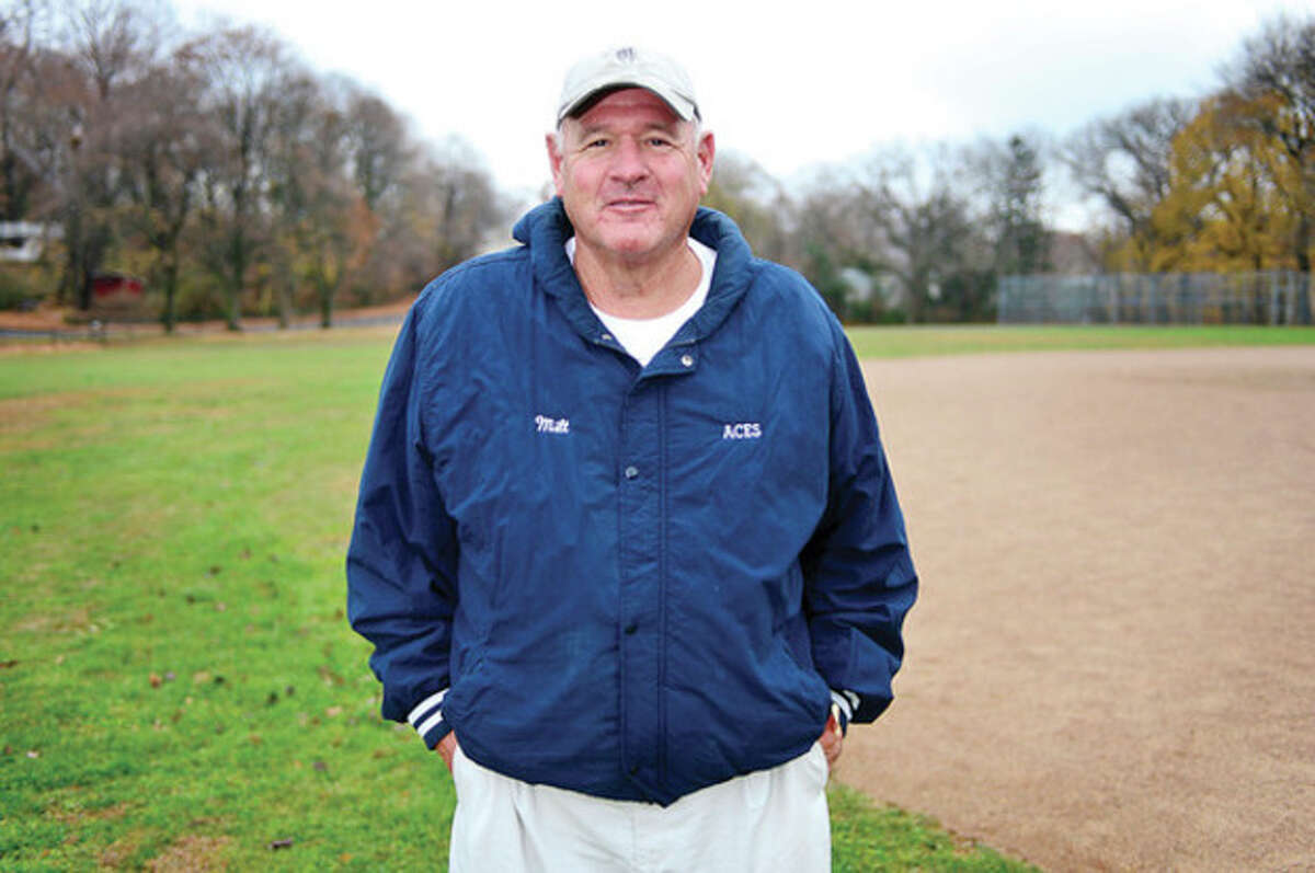 Hour photo/Erik Trautmann Wearing his Aces jacket, the iconic team he helped start nearly half a century ago, Milt Peckham stands on the same field where he starred in football and baseball for Norwalk High School in the early 1960s.
