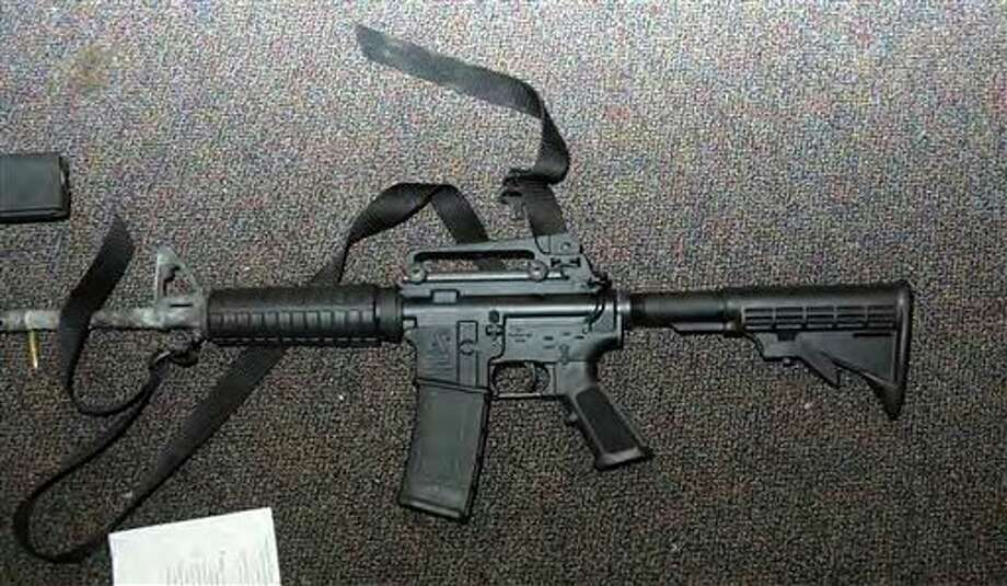 """This image contained in the """"Appendix to Report on the Shootings at Sandy Hook Elementary School and 36 Yogananda St., Newtown, Connecticut On December 14, 2012"""" and released Monday, Nov. 25, 2013, by the Danbury, Conn., State's Attorney shows a weapon found at Sandy Hook Elementary School in Newtown, Conn. Adam Lanza opened fire inside the school killing 20 first-graders and six educators before killing himself as police arrived. (AP Photo/Office of the Connecticut State's Attorney Judicial District of Danbury) / Office of the Connecticut State's Attorney Judicial District of"""