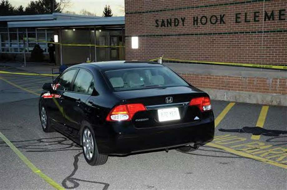 "This image contained in the ""Appendix to Report on the Shootings at Sandy Hook Elementary School and 36 Yogananda St., Newtown, Connecticut On December 14, 2012"" and released Monday, Nov. 25, 2013, by the Danbury, Conn., State's Attorney shows a vehicle outside Sandy Hook Elementary School in Newtown, Conn. Adam Lanza opened fire inside the school killing 20 first-graders and six educators before killing himself as police arrived. (AP Photo/Office of the Connecticut State's Attorney Judicial District of Danbury) / Office of the Connecticut State's Attorney Judicial District of"