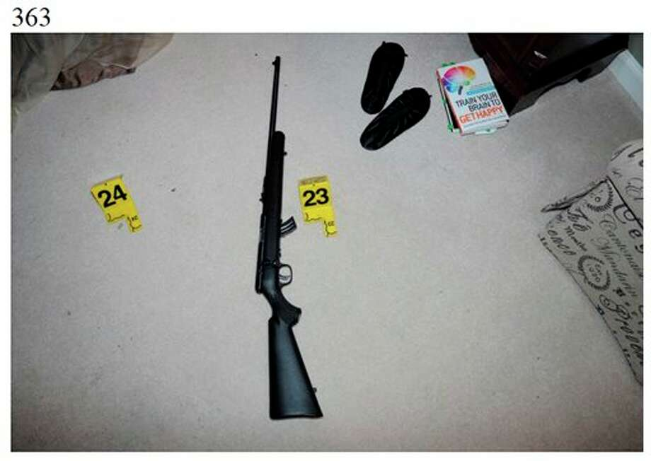 """This image contained in the """"Appendix to Report on the Shootings at Sandy Hook Elementary School and 36 Yogananda St., Newtown, Connecticut On December 14, 2012"""" and released Monday, Nov. 25, 2013, by the Danbury, Conn., State's Attorney shows a scene at 36 Yogananda St., where gunman Adam Lanza lived with his mother in Newtown, Conn. Lanza opened fire inside the school killing 20 first-graders and six educators, before killing himself as police arrived. (AP Photo/Office of the Connecticut State's Attorney Judicial District of Danbury) / Office of the Connecticut State's Attorney Judicial District of"""