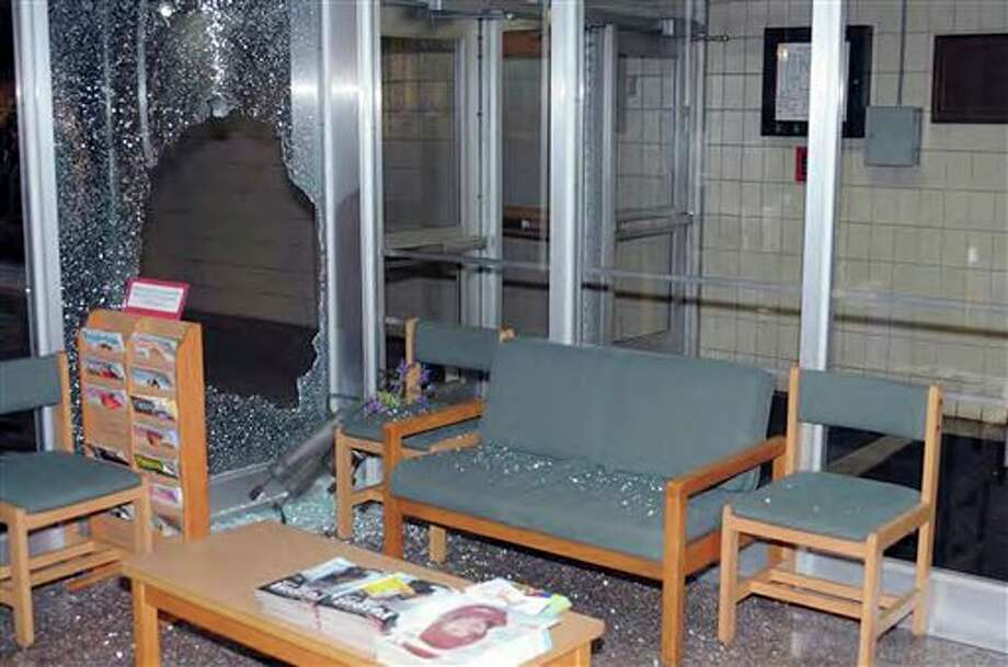 "This image contained in the ""Appendix to Report on the Shootings at Sandy Hook Elementary School and 36 Yogananda St., Newtown, Connecticut On December 14, 2012"" and released Monday, Nov. 25, 2013, by the Danbury, Conn., State's Attorney shows a scene inside the entrance to Sandy Hook Elementary School in Newtown, Conn. Adam Lanza opened fire inside the school killing 20 first-graders and six educators before killing himself as police arrived. (AP Photo/Office of the Connecticut State's Attorney Judicial District of Danbury) / Office of the Connecticut State's Attorney Judicial District of"