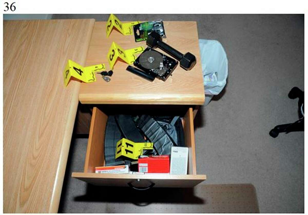 This image contained in the appendix of a summary report on the shootings at Sandy Hook Elementary School and 36 Yogananda St., in Newtown, Conn., on Dec. 14, 2012, and released Monday, Nov. 25, 2013, by the Danbury, Conn., State's Attorney shows a scene at 36 Yogananda St., where gunman Adam Lanza lived with his mother in Newtown, Conn. Lanza opened fire inside the school killing 20 first-graders and six educators before killing himself as police arrived. (AP Photo/Office of the Connecticut State's Attorney Judicial District of Danbury)