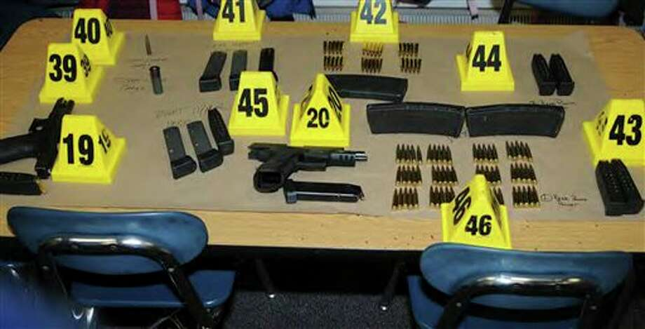 "This image contained in the ""Appendix to Report on the Shootings at Sandy Hook Elementary School and 36 Yogananda St., Newtown, Connecticut On December 14, 2012"" and released Monday, Nov. 25, 2013, by the Danbury, Conn., State's Attorney shows weapons and ammunition found at Sandy Hook Elementary School in Newtown, Conn. Adam Lanza opened fire inside the school killing 20 first-graders and six educators before killing himself as police arrived. (AP Photo/Office of the Connecticut State's Attorney Judicial District of Danbury) / Office of the Connecticut State's Attorney Judicial District of"