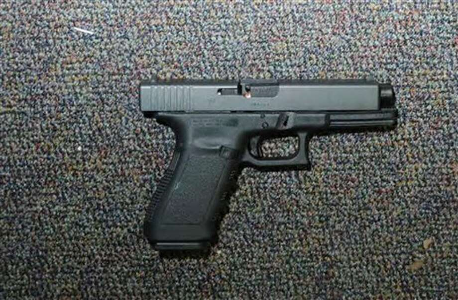 """This image contained in the """"Appendix to Report on the Shootings at Sandy Hook Elementary School and 36 Yogananda St., Newtown, Connecticut On December 14, 2012"""" and released Monday, Nov. 25, 2013, by the Danbury, Conn., State's Attorney shows a weapon at Sandy Hook Elementary School in Newtown, Conn. Adam Lanza opened fire inside the school killing 20 first-graders and six educators before killing himself as police arrived. (AP Photo/Office of the Connecticut State's Attorney Judicial District of Danbury) / Office of the Connecticut State's Attorney Judicial District of"""