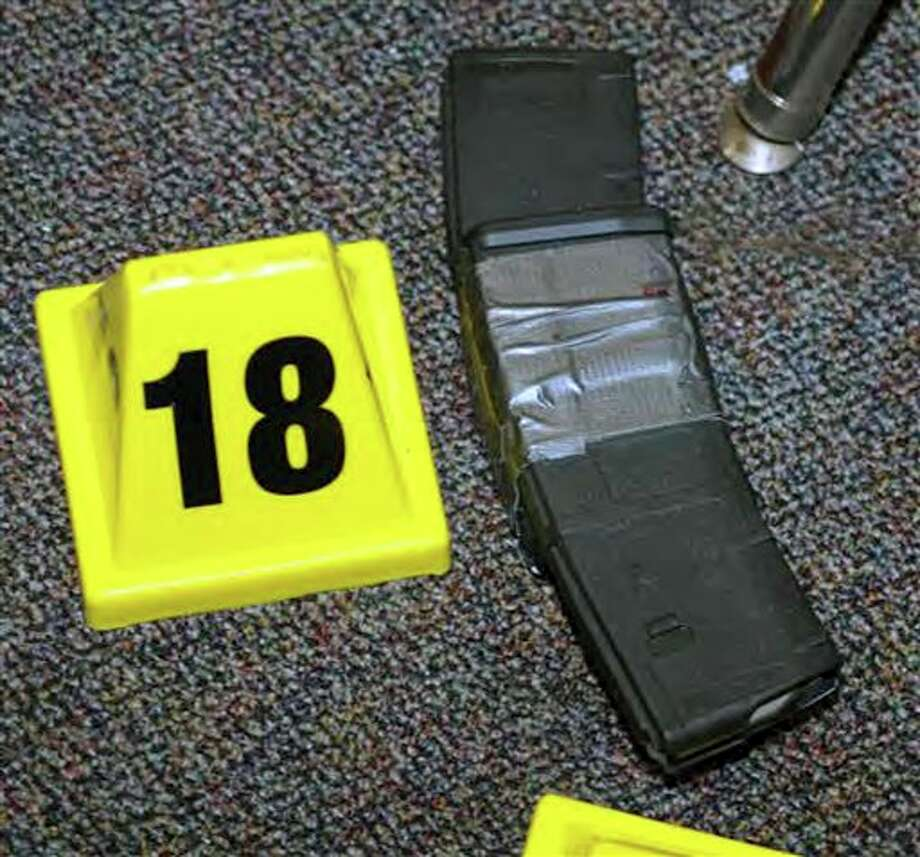 """This image contained in the """"Appendix to Report on the Shootings at Sandy Hook Elementary School and 36 Yogananda St., Newtown, Connecticut On December 14, 2012"""" and released Monday, Nov. 25, 2013, by the Danbury, Conn., State's Attorney shows an ammunition magazine at Sandy Hook Elementary School in Newtown, Conn. Adam Lanza opened fire inside the school killing 20 first-graders and six educators before killing himself as police arrived. (AP Photo/Office of the Connecticut State's Attorney Judicial District of Danbury) / Office of the Connecticut State's Attorney Judicial District of"""