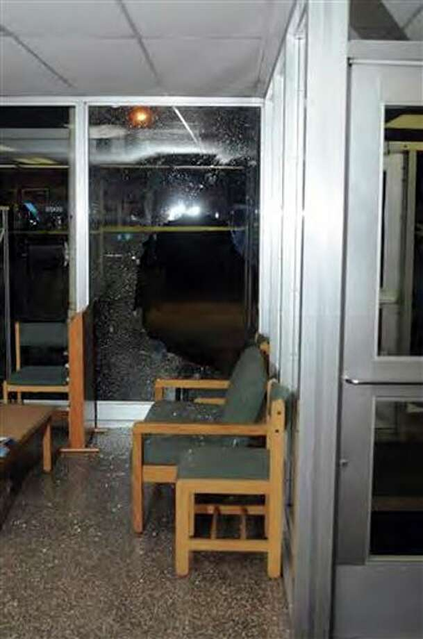 """This image contained in the """"Appendix to Report on the Shootings at Sandy Hook Elementary School and 36 Yogananda St., Newtown, Connecticut On December 14, 2012"""" and released Monday, Nov. 25, 2013, by the Danbury, Conn., State's Attorney shows a scene inside the entrance to Sandy Hook Elementary School in Newtown, Conn. Adam Lanza opened fire inside the school killing 20 first-graders and six educators before killing himself as police arrived. (AP Photo/Office of the Connecticut State's Attorney Judicial District of Danbury) / Office of the Connecticut State's Attorney Judicial District of"""