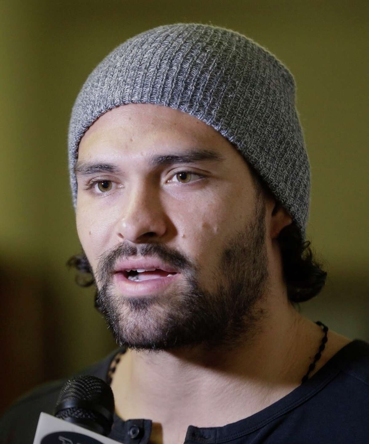 New York Jets FL football quarterback Mark Sanchez is interviewed during a visit to the Community Soup Kitchen of Morristown as part of the team's Thanksgiving Day week celebration, Tuesday, Nov. 26, 2013, in Morristown, N.J. (AP Photo/Julio Cortez)