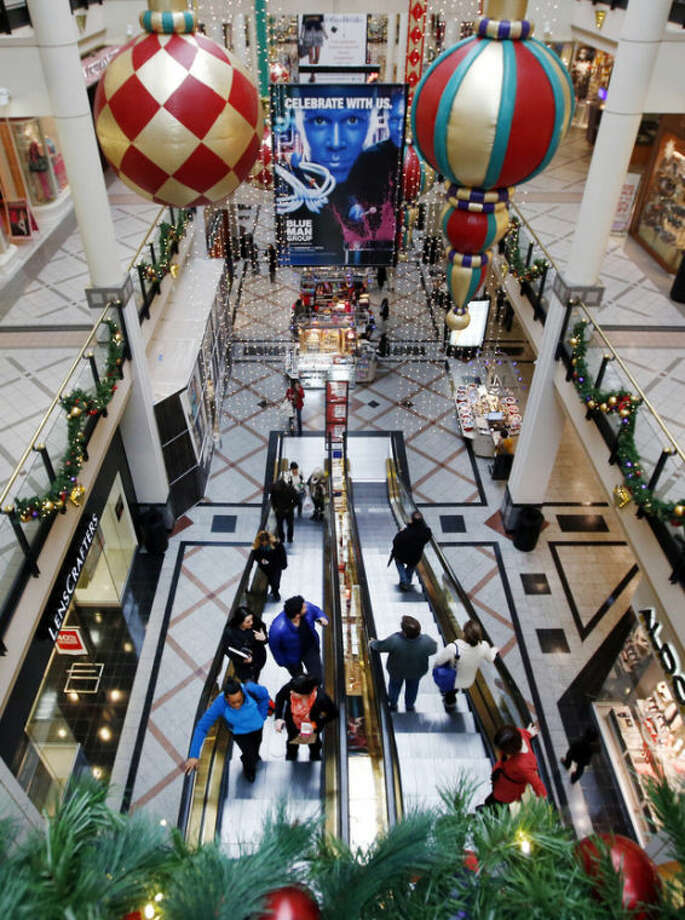 "Shoppers ride escalators in a mall in Cambridge, Mass., Tuesday, Nov. 26, 2013. Shoppers in many states will line up for deals hours after their Thanksgiving dinners, but stores in a handful of states are barred by law from opening on the holiday. Rhode Island, Massachusetts and Maine have so-called ""blue laws"" that bar many big stores from opening Thursday. (AP Photo/Elise Amendola)"