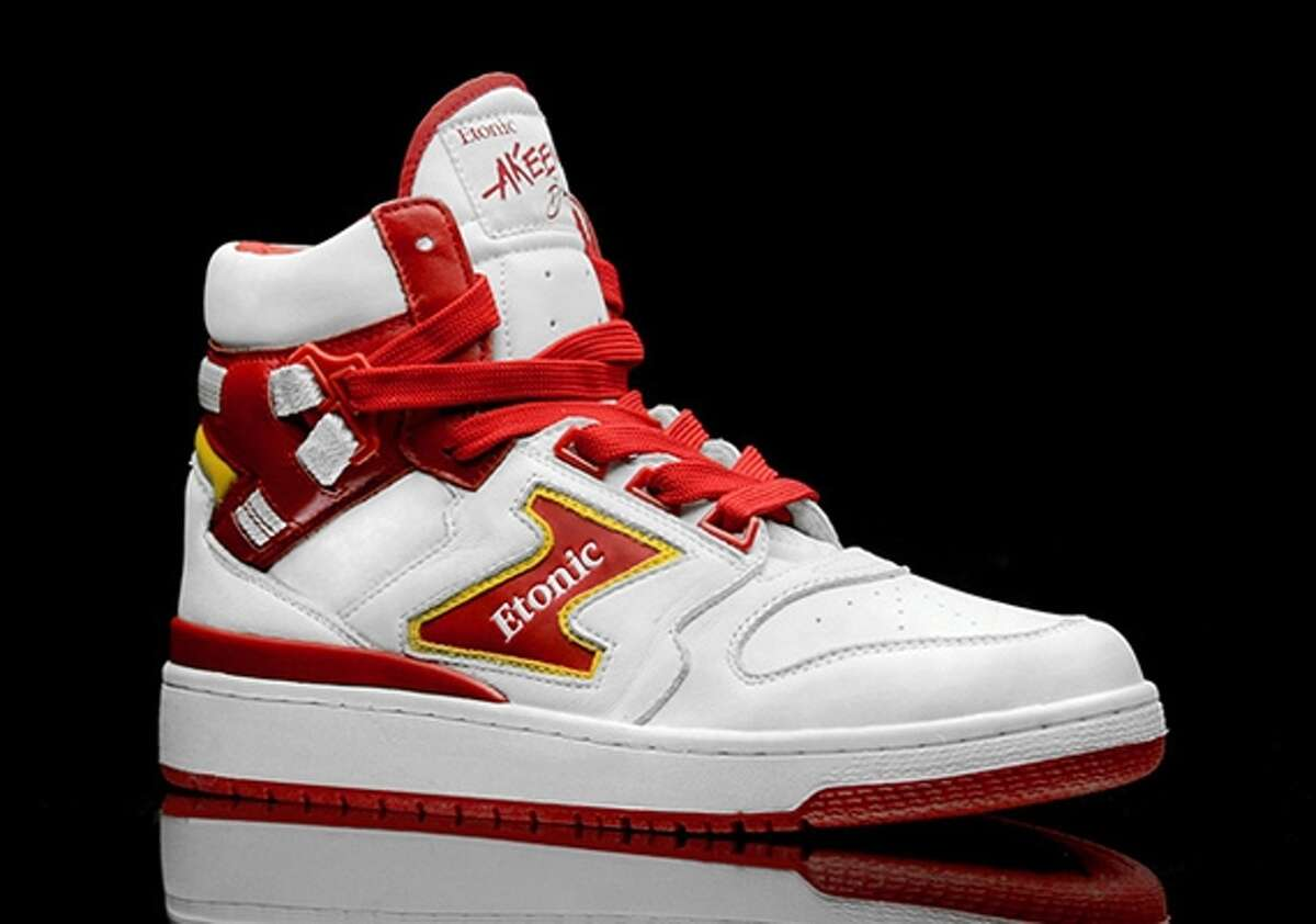 """Akeem Olajuwon's Etonic shoes These actually are kind of cool if you wore them in a retro way these days, but they were never very attractive. Akeem - before he added the H - wore these in his rookie season. The tongue saying """"Akeem the Dream"""" was a nice touch."""