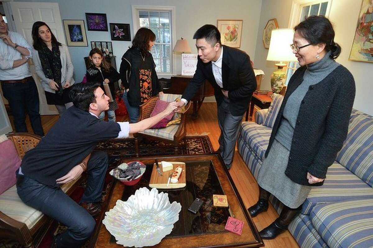 Hour Photo/Alex von Kleydorff Fullbright Scholars Kuangyu Liu and Yukun Hu meet family and friends as they arrive at Saul Haffner and Barbara Jay's Westport home for Thanksgiving.