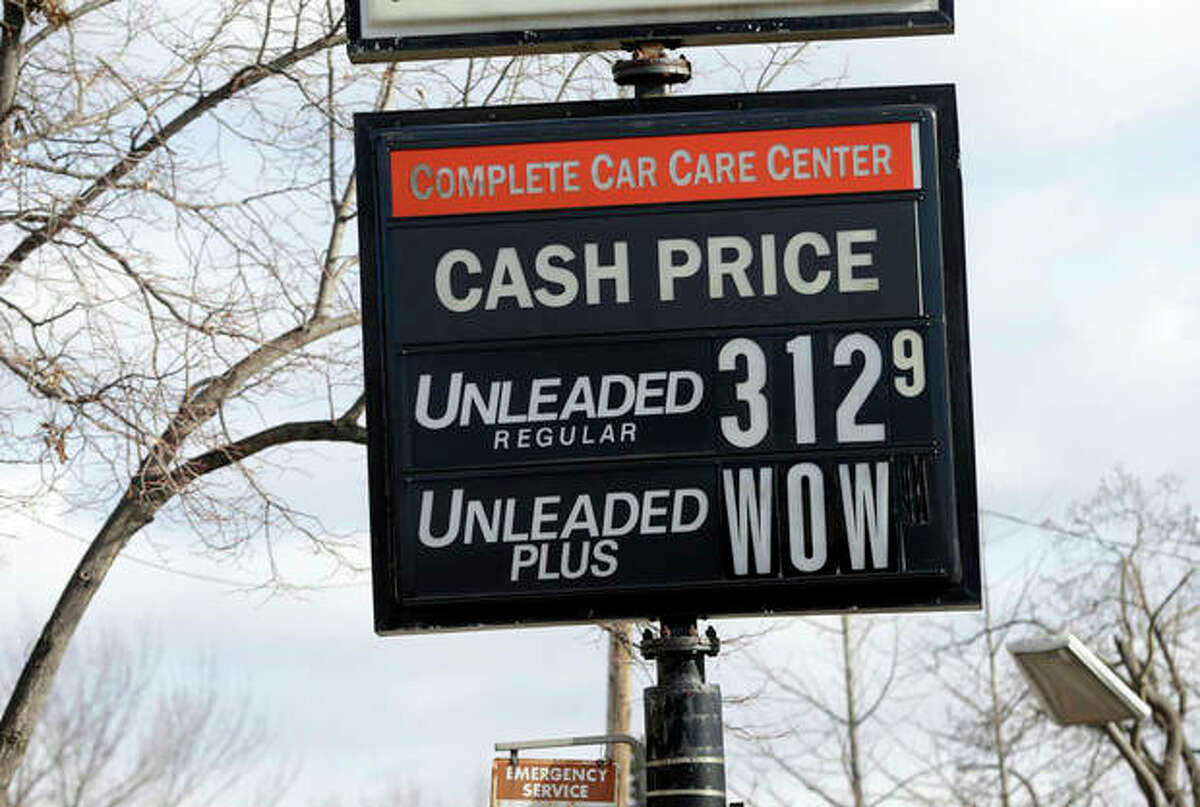 AP Photo/Jim Mone The cash price for unleaded fuel along with an editorial comment on unleaded-plus fuel was posted on a sign at a Minneapolis care care center Tuesday, Nov. 26, in Minneapolis, as gas prices continue to fall just in time for Thanksgiving and holiday spending. The average price of gasoline has tumbled 49 cents from their peak this year to $3.29 a gallon, putting shoppers on track to have the lowest prices at the pump since 2010, according to AAA.