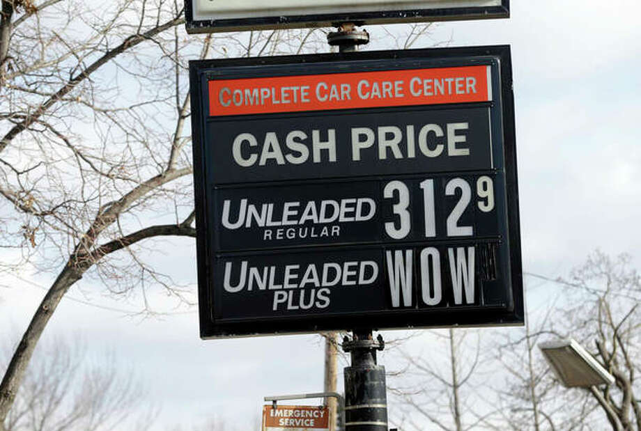 AP Photo/Jim MoneThe cash price for unleaded fuel along with an editorial comment on unleaded-plus fuel was posted on a sign at a Minneapolis care care center Tuesday, Nov. 26, in Minneapolis, as gas prices continue to fall just in time for Thanksgiving and holiday spending. The average price of gasoline has tumbled 49 cents from their peak this year to $3.29 a gallon, putting shoppers on track to have the lowest prices at the pump since 2010, according to AAA. / AP