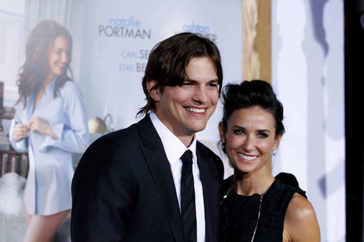 FILE - This Jan. 11, 2011 file photo shows cast member Ashton Kutcher, left, and Demi Moore at the premiere for