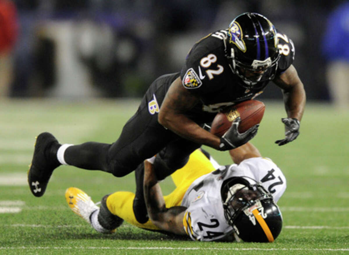 Baltimore Ravens wide receiver Torrey Smith (82) is tackled by Pittsburgh Steelers cornerback Ike Taylor in the second half of an NFL football game, Thursday, Nov. 28, 2013, in Baltimore. Baltimore won 22-20. (AP Photo/Nick Wass)