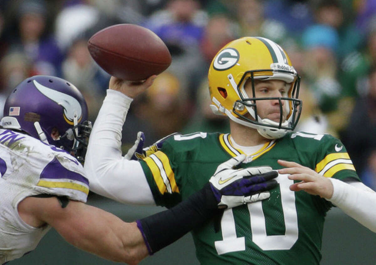 Green Bay Packers' Matt Flynn throws while being pressured by Minnesota Vikings' Brian Robison during the second half of an NFL football game Sunday, Nov. 24, 2013, in Green Bay, Wis. The game ended in a tie, 26-26. (AP Photo/Morry Gash)