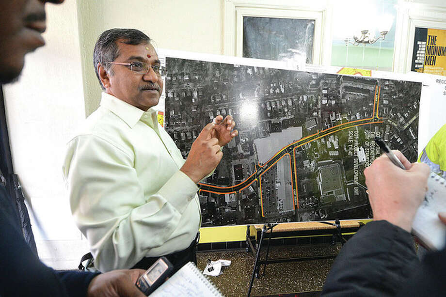 Hour Photo/Alex von Kleydorff City of Stamford Traffic Engineer Mani Poola goes over the details of the Hope St. Construction at an ariel map of the project