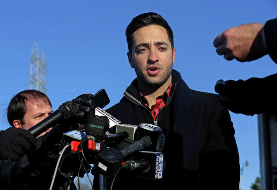 Milwaukee Brewers outfielder Ryan Braun talks about his baseball suspension outside Miller Park Wednesday, Nov. 27, 2013, in Milwaukee. (AP Photo/Morry Gash) / AP