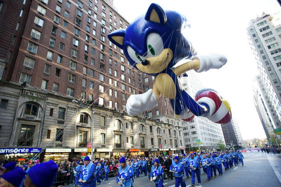 FILE - In this Nov. 22, 2012, file photo, handlers keep a tight rein on the Sonic the Hedgehog balloon as it travels the route of the Macy's Thanksgiving Day Parade in New York. Macy's says it is closely monitoring the weather after recent forecasts predicted wind gusts up to 30 mph on Thanksgiving morning during the department store's upcoming Thanksgiving Day Parade. Based on New York City guidelines, no giant balloons will be operated if the wind gusts exceed 34 mph. (AP Photo/Charles Sykes, File) / FR170266 AP