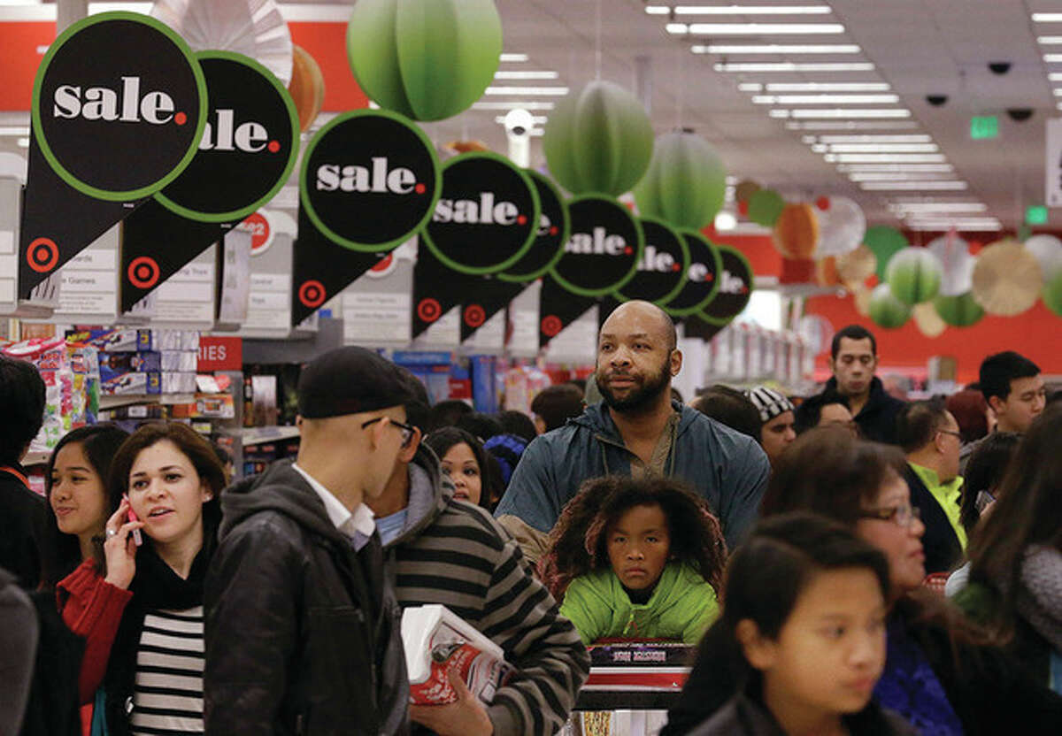 AP Photo / Jeff Chiu People shop at a Target store in Colma, Calif. Thursday. Instead of waiting for Black Friday, which is typically the year's biggest shopping day, more than a dozen major retailers opened on Thanksgiving day this year.