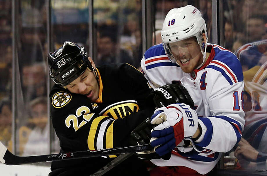 Boston Bruins' Shawn Thornton, left, checks New York Rangers' Marc Staal during the second period of an NHL hockey game in Boston, Friday, Nov. 29, 2013. (AP Photo/Winslow Townson) / FR170221 AP